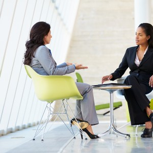 bigstock-Two-Businesswomen-Meeting-Arou-42381475